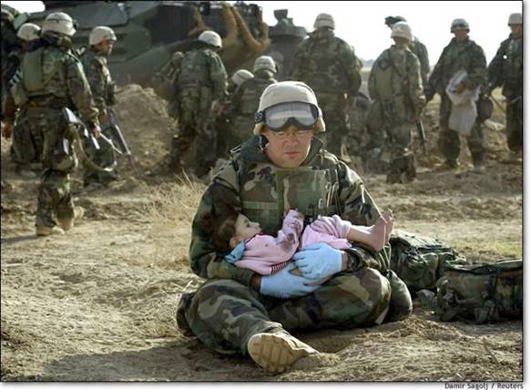 soldier holding orphan child